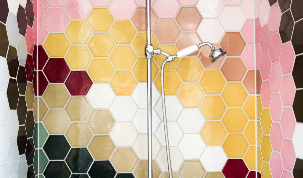 PATCHWORK tiles in the shower / detail of multicolour pattern of a giant ice cream waffle