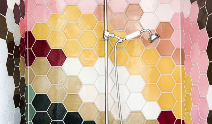 PATCHWORK tiles in the shower / detail with multicolour pattern of a giant ice cream waffle