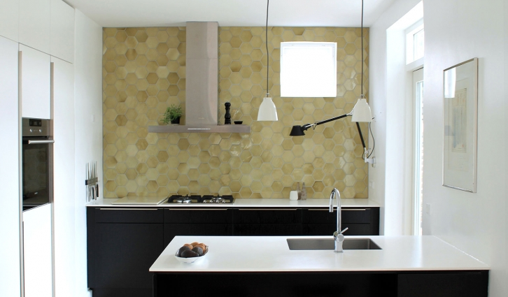 This fabulous Olive green wall is a perfect contrast to the black and white kitchen elements